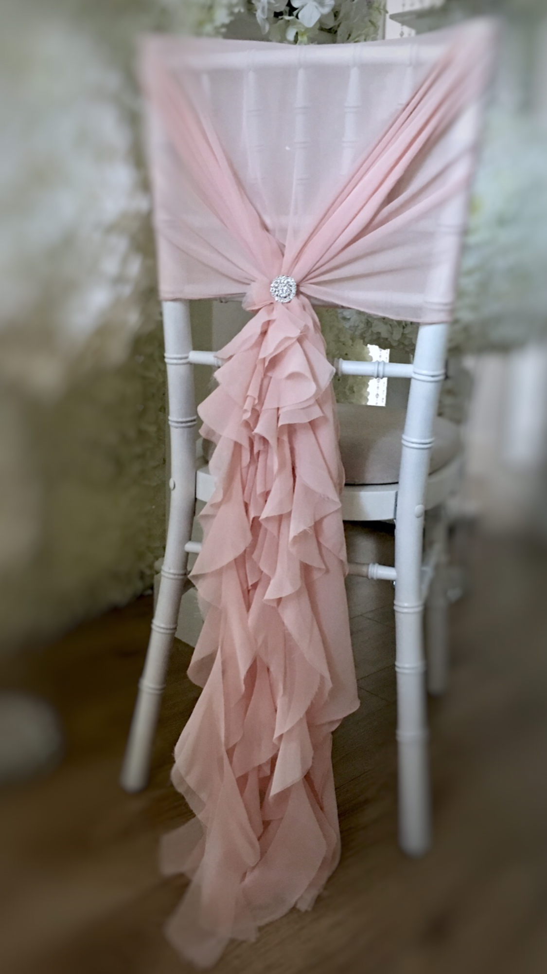 Blush pink chair hoods and ruffles