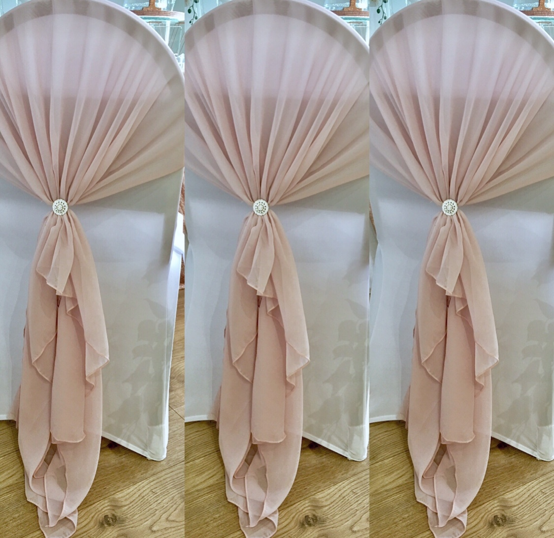 Pale pink chiffon chair drapes