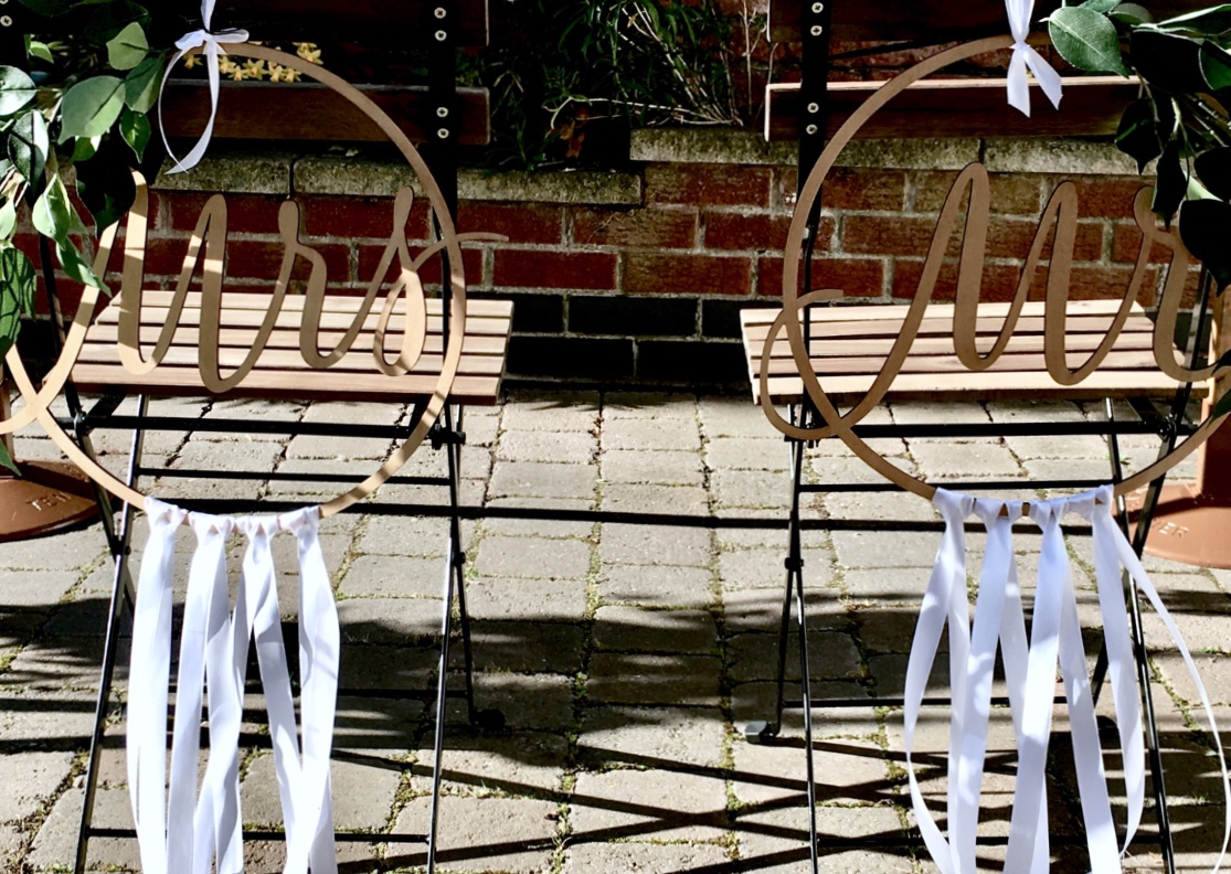 Rustic bride and groom chair hire